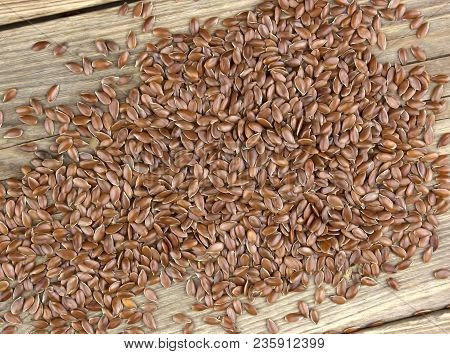 Flax Seeds On Wooden Background.  Also Known As Linseed, Flaxseed And Common Flax. Pile Of Grains, I
