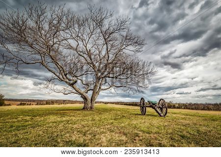A Lone Cannon Sitting On A Civil War Battlefield In Virginia.