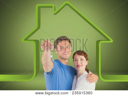 Couple Holding key with house icon in front of vignette