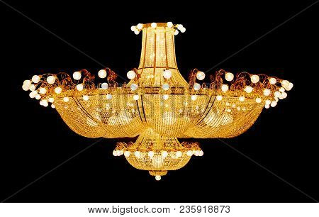 Huge Luxurious Crystal Electric Chandelier Isolated On A Black Background