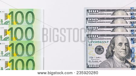 One Hundred Euro And New One Hundred Dollar Bills. Background Of The Money.