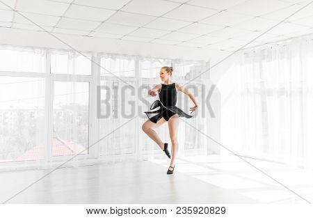 Beautiful graceful ballerina spinning on one leg