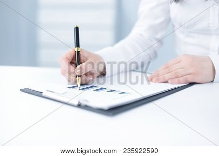 Closeup.business Woman Analyzing The Financial Schedule .photo With Copy Space