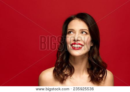 beauty, make up and people concept - happy smiling young woman with red lipstick