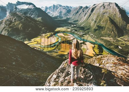 Traveler Girl Standing On Cliff Above Mountains Valley Landscape Traveling Solo Adventure Lifestyle