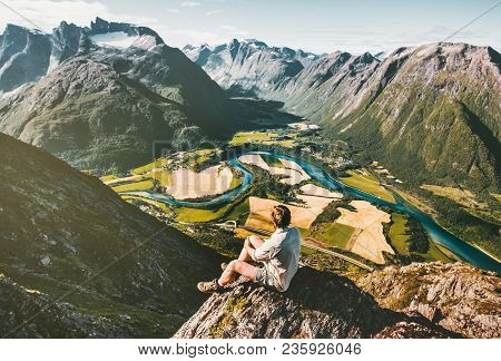 Man Traveler Relaxing On Cliff Alone Aerial Mountains Valley Landscape Traveling Adventure Lifestyle