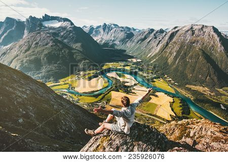 Happy Man Traveler Alone Relaxing On Cliff Success Raised Hands Enjoying Aerial Mountains Landscape