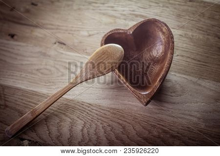Closeup. Empty Wooden Salad Bowl And Wooden Paddle On A Wooden Table