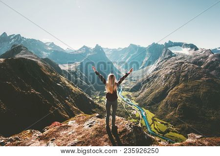 Woman Traveler Raised Arms Standing Alone On Cliff In Mountains Landscape Travel Healthy Lifestyle A