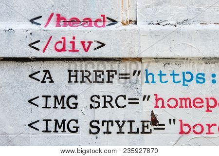 Stencil Of Html Code On White Wall