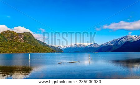 Pitt Lake With The Snow Capped Peaks Of The Golden Ears, Tingle Peak And Other Mountain Peaks Of The