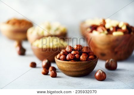 Hazelnuts In Wooden Bowl. Food Mix Background, Top View, Copy Space, Banner. Assortment Of Nuts - Ca