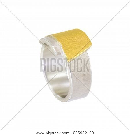 Ladies Ring In Sterling Silver. On A Wide Ring Band Is A Trapezoid Made Of Silver With A Gold Solder