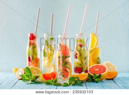 Variety Of Fruit Infused Detox Water In Small Bottles. Set Of Refreshing Summer Drinks. Healthy Diet