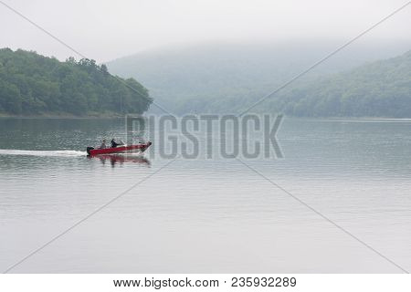 A Fishing Boat On The Allegheny Reservoir In Pennsylvania. The Boat Is Moving Quickly On The Water,