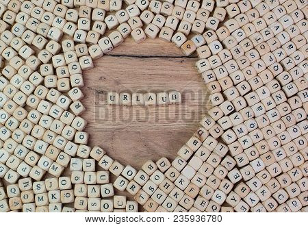 Urlaub, German Text For Holiday, Word In Letters On Cube Dices On Table