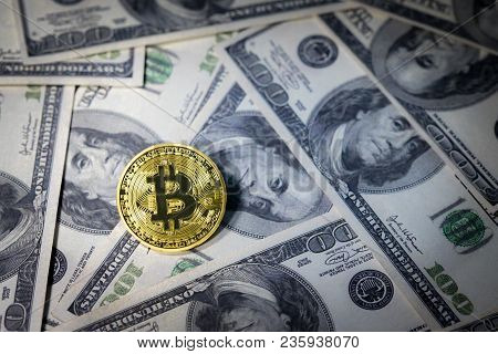 Golden Bitcoin On One Hundred Dollar Banknotes. Mining Concept, Electronic Money Exchange Concept, C