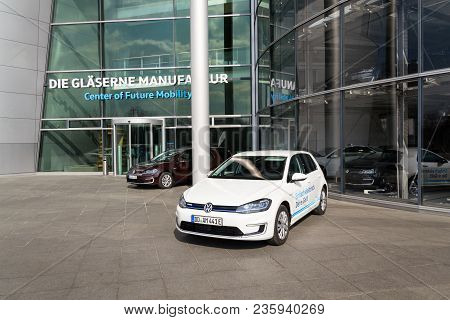 Dresden, Germany - April 2 2018: Plug-in Hybrid Volkswagen E-golf Electric Car Stands By Charging St