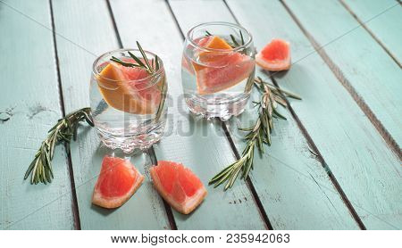 Fresh Drink With Grapefruit And Rosemary On Blue Green Shabby Chic Background