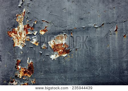 The Old And Rusty Metal Sheet Painted With Oxided And Cracking On Surface