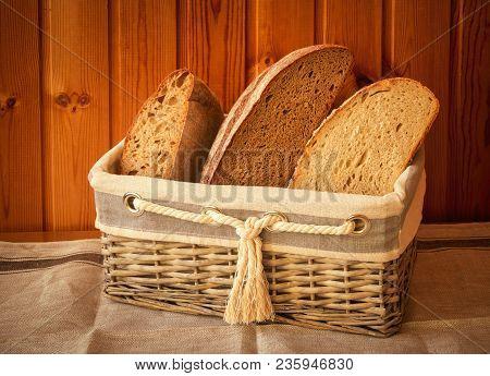 Wicker Basket With Fresh Bread. Vintage Style.