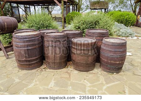 Stacked Wine Barrels. Decoration Of The Barrels In The Village Ataman