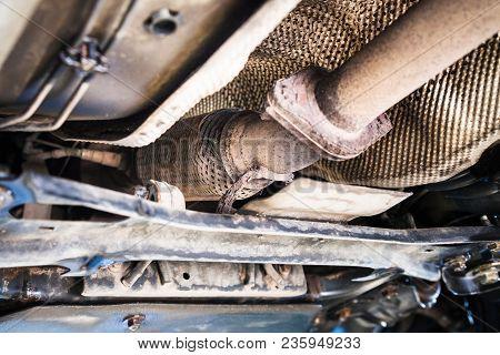 Repairing Of Corrugation Muffler Of Exhaust System In Car Workshop - Bottom View Of Old Broken Corru