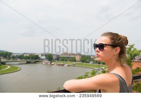 Woman Look At Vistula River In Krakow, Poland. Sensual Woman In Sunglasses On Sunny Day. Summer Vaca