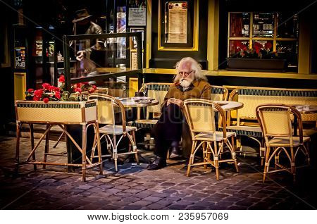 Brussels, Belgium. January 26, 2018. An Unknown Elegant Belgian Old Man Enjoying Champagne In A Stre
