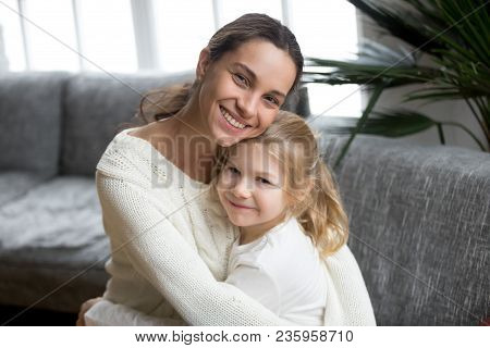 Portrait Of Happy Loving Single Mother Hugging Cute Little Daughter, Smiling Young Woman Embracing P