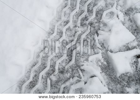 Full-frame Tire Tracks Printed In The Snow