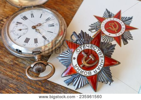 Soviet Order Of Patriotic War (inscription Patriotic War) With Vintage Pocket Chronometer On An Old