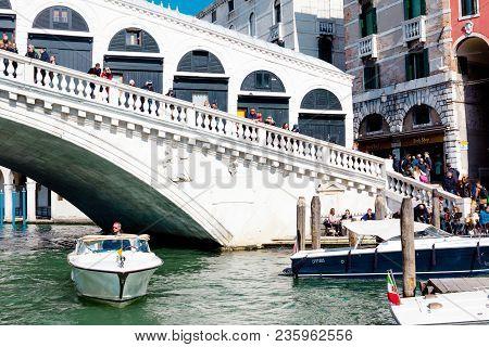 The Rialto Bridge, Grand Canal In Venice, Italy. 03/23/2018