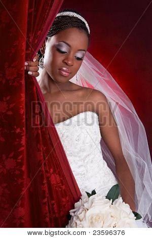Beautiful African American Bridal Portrait on Red Dark Background