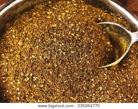 Spices For Pizza With Metallic Scoop Close Up