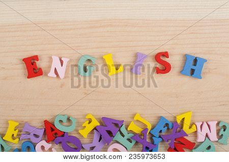 English Word On Wooden Background Composed From Colorful Abc Alphabet Block Wooden Letters, Copy Spa