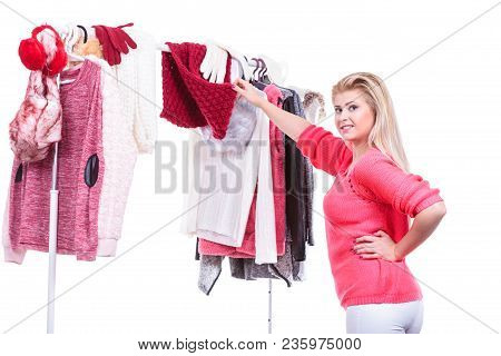 Young Woman Indecision In Wardrobe Home Closet, Teen Blonde Girl Choosing Her Warm Fashion Outfit On