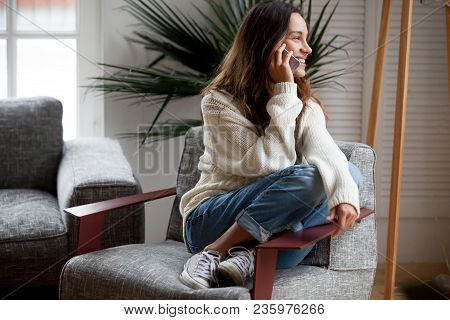 Happy Cheerful Young Woman Talking On The Phone At Home, Smiling Teen Girl Making Answering Call By