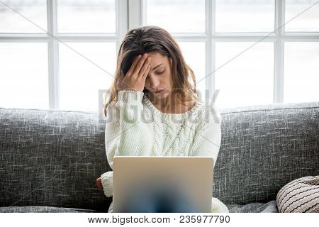 Frustrated Sad Woman Feeling Tired Worried About Problem Sitting On Sofa With Laptop, Stressed Depre
