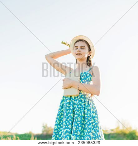 Young Romantic Girl With Book Enjoy Summer