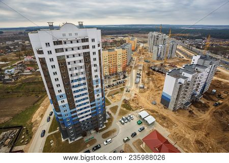Panoramic View On Construction Of  New Quarter Tower Unfinished Multi-storey High Building From A Bi