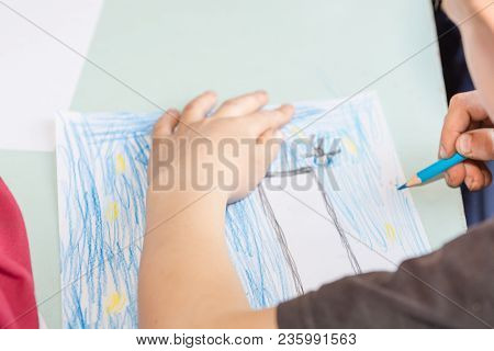 The Child Is Drawing. Draws On A Piece Of Paper. Children Have Fun. Draws A Postcard. The Child Draw