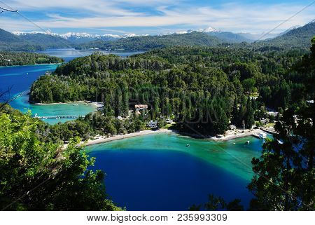 Beautiful Incredible View Of A Blue, Green And Turquoise Bay Of A Lake, Surrounded By A Forest And W