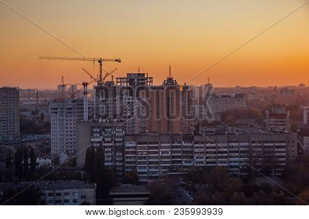 High-rise Buildings Construction Site On  Sunset Sky Background. Voronezh, Russia.