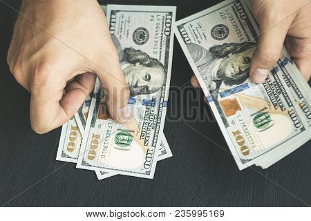 Hand Recount Dollars. The Man Counts The Money. New Hundred-dollar Bills