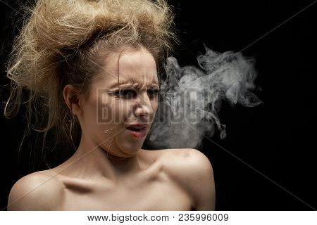 Girl Coughs From Tobacco Smoke On Black Background