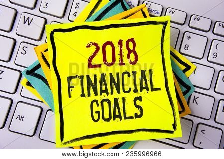 Writing Note Showing  2018 Financial Goals. Business Photo Showcasing New Business Strategy Earn Mor