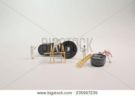A Mini Woker Clearing The Mini Lens
