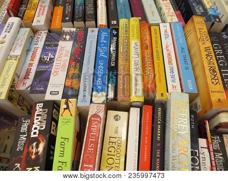 TANGERANG, INDONESIA - April 9, 2018: Rows of fiction books for sale on books fair at ICE BSD City.