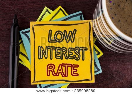 Writing Note Showing  Low Interest Rate. Business Photo Showcasing Manage Money Wisely Pay Lesser Ra
